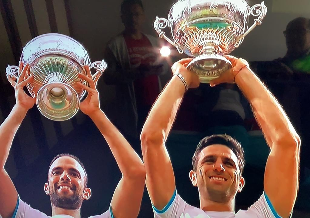 Cabal and Farah with the Wombledon title