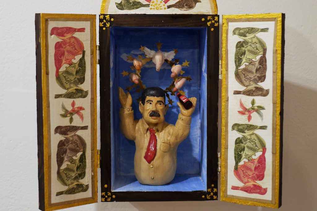 The 'dick-tator'?  Maduro with flying penises in retablo-style art by Andrés Chaparro. Photo: Steve Hide.