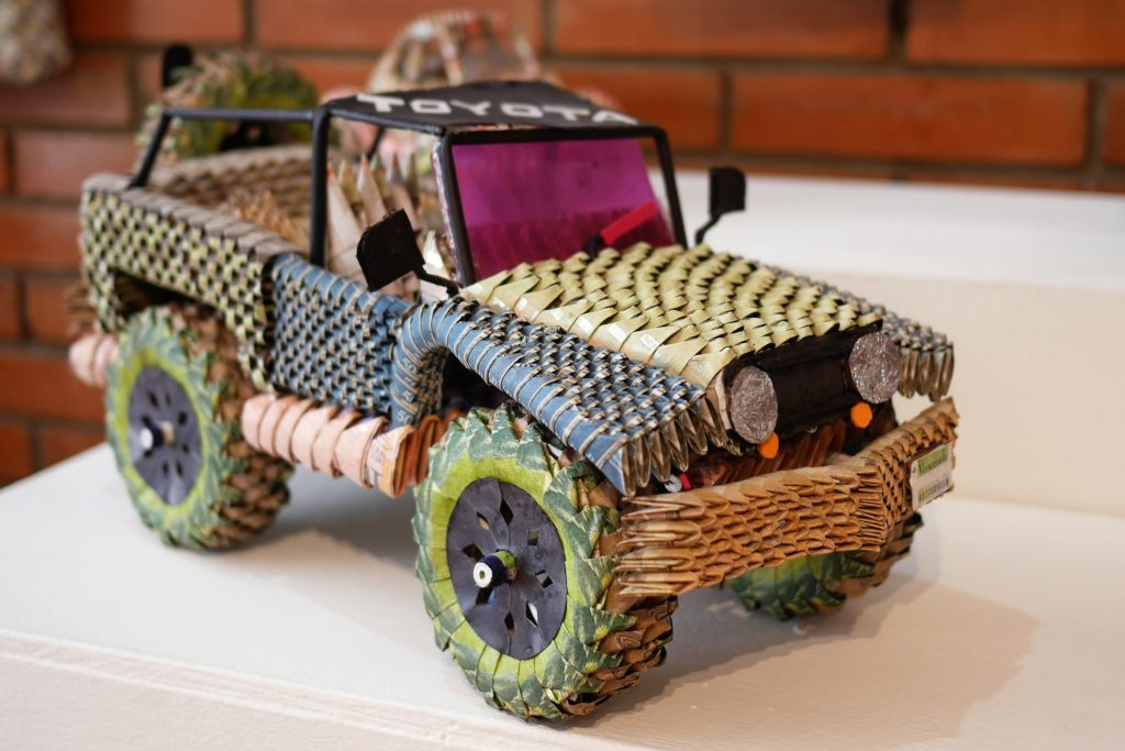 Bankrolling: a carefully crafted car made of bolivar notes. Even the wheels turn. Photo: Steve Hide.