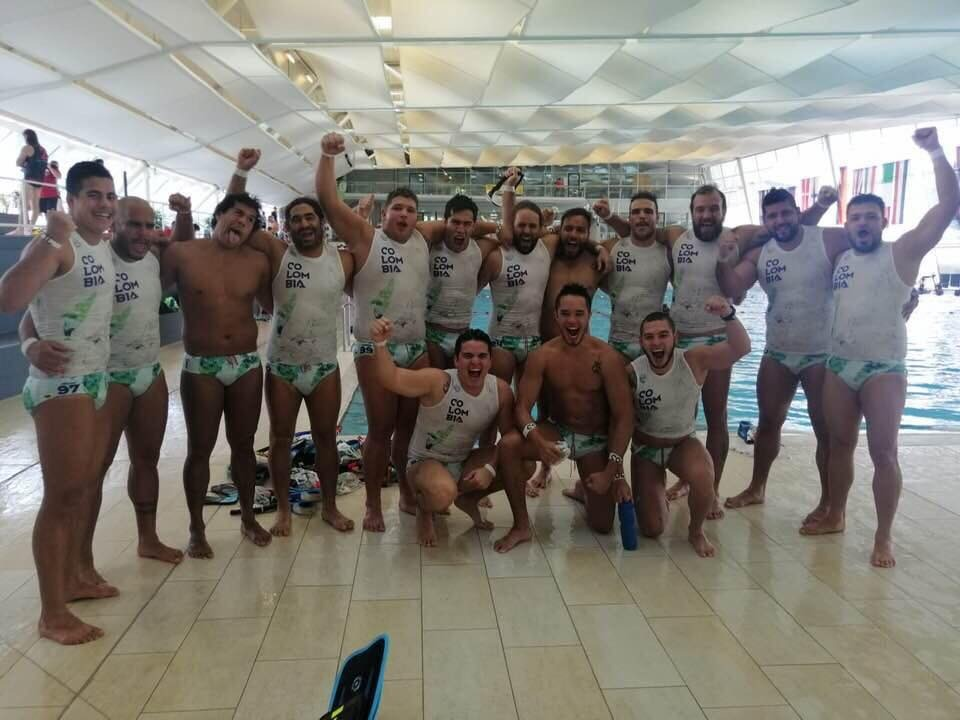 The men celebrating their first ever World Championship title underwater rugby.
