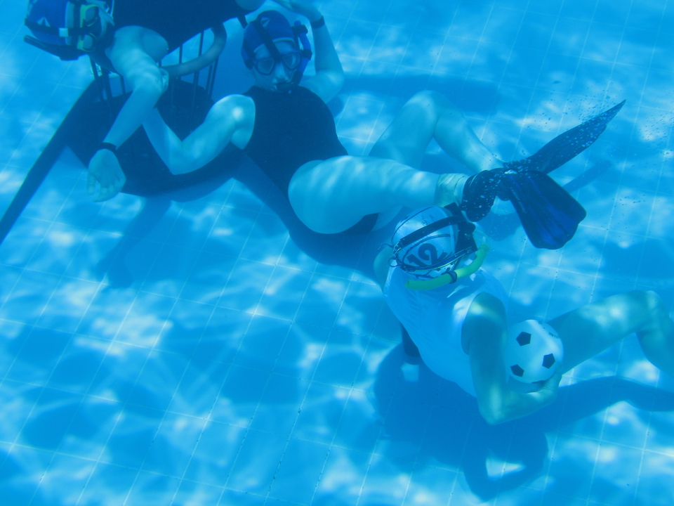 Underwater rugby draws on elements of water polo and basketball, though oddly enough hardly resembles rugby.
