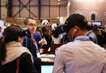 students wear VR headsets at a VR conference the