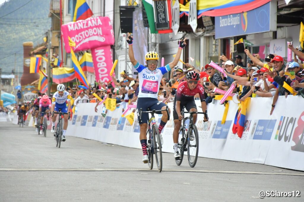 Higuita passing the finish line ahead of Egan Bernal.