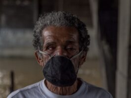 Marco Aguirre, one of Medellín's homeless, in a face mask