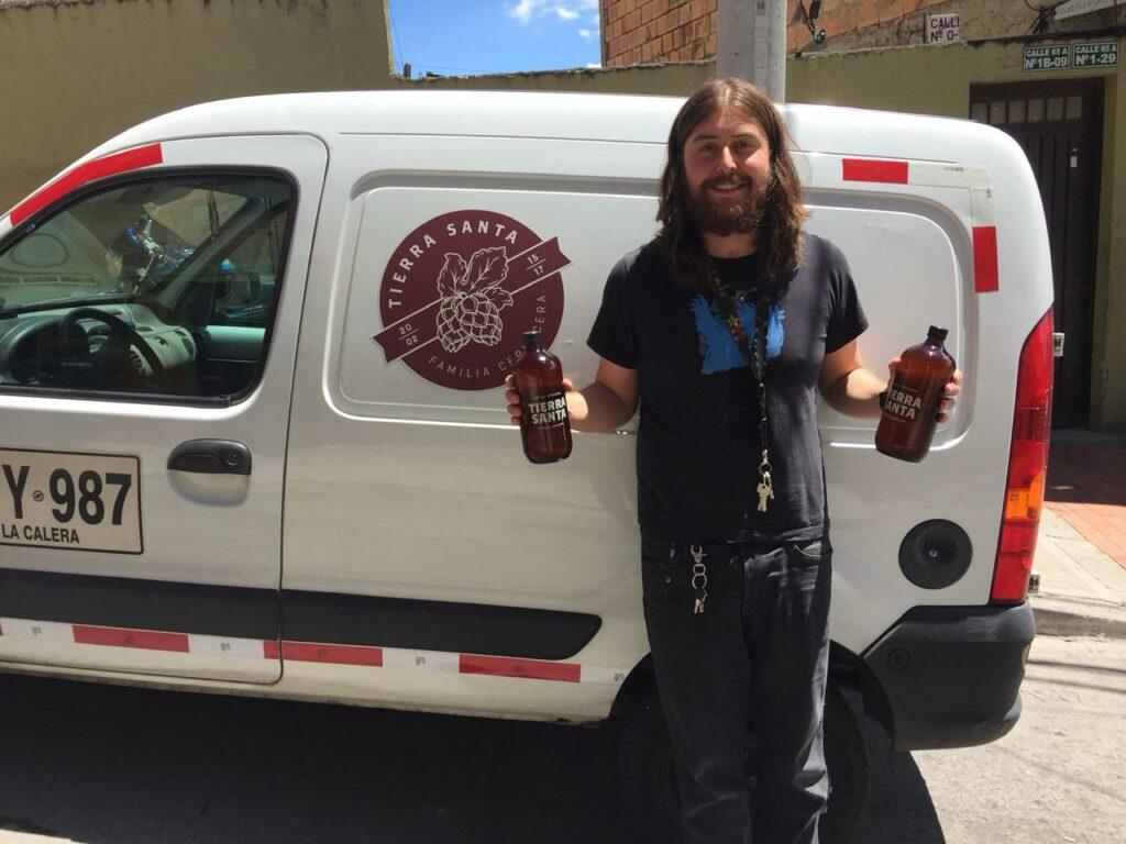 Tierra Santa brewer Julian Salamanca in front of his delivery van.